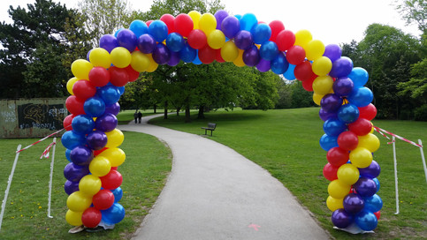 Mulitcoloured Spiral Arch Rainbow Run Finish Line