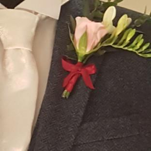 Fresh pink rose & freesia buttonhole