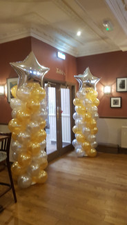 Silver & Gold column with star toppers