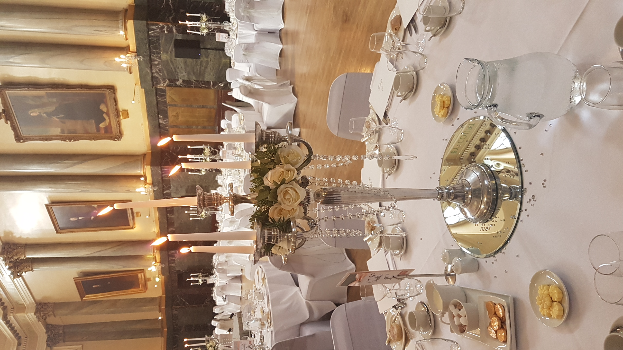 Candelabra with cream rose rings
