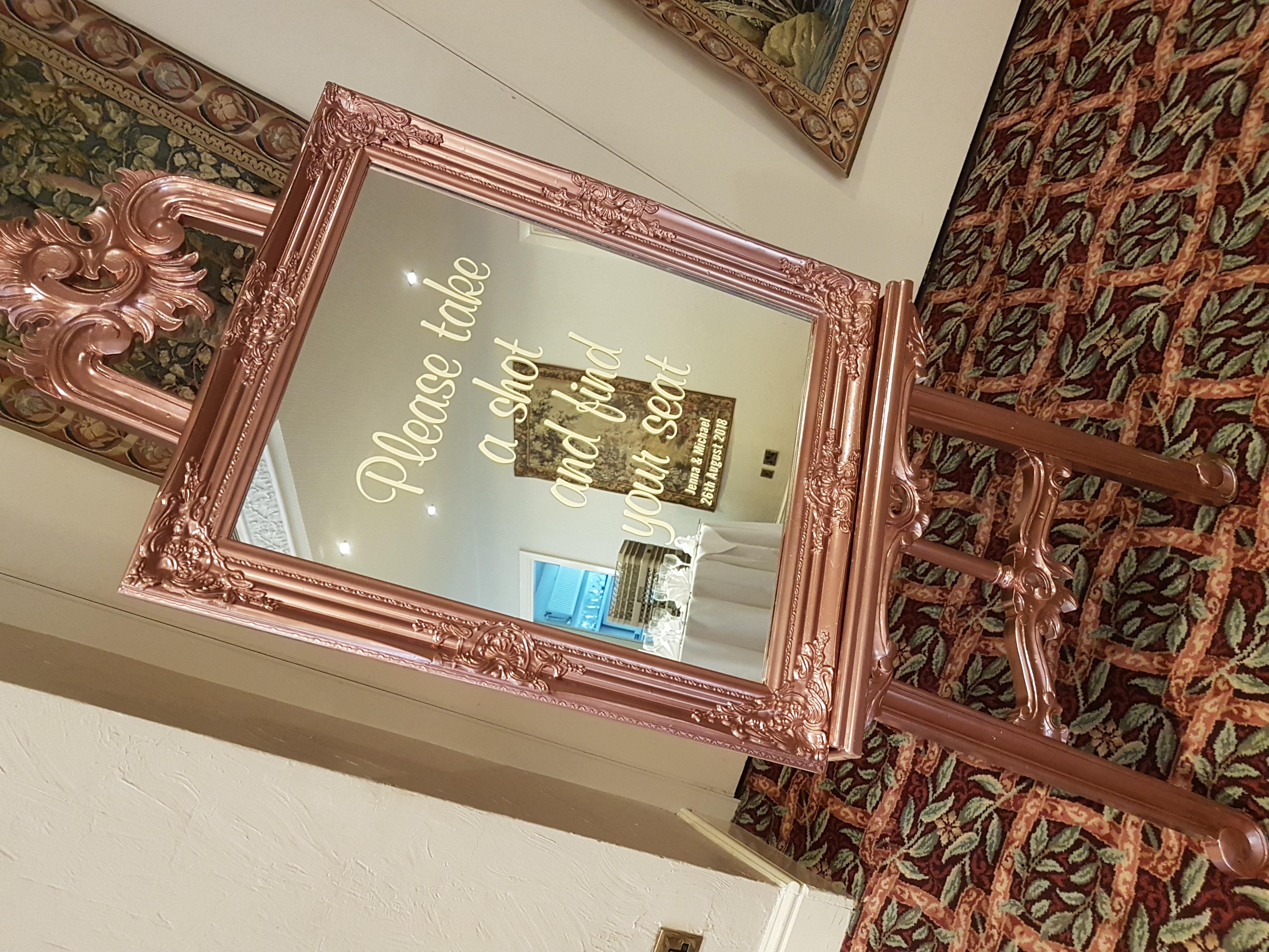 Vinyl sign on rose gold mirror