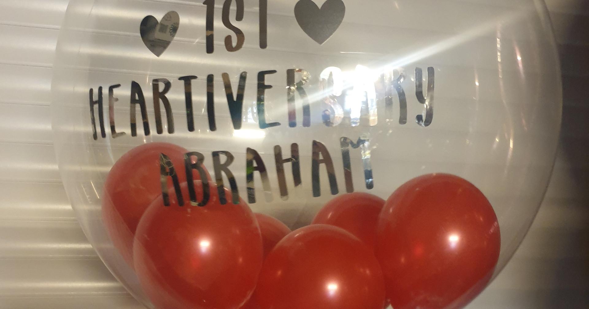 Red happy heartiversary bubble balloon