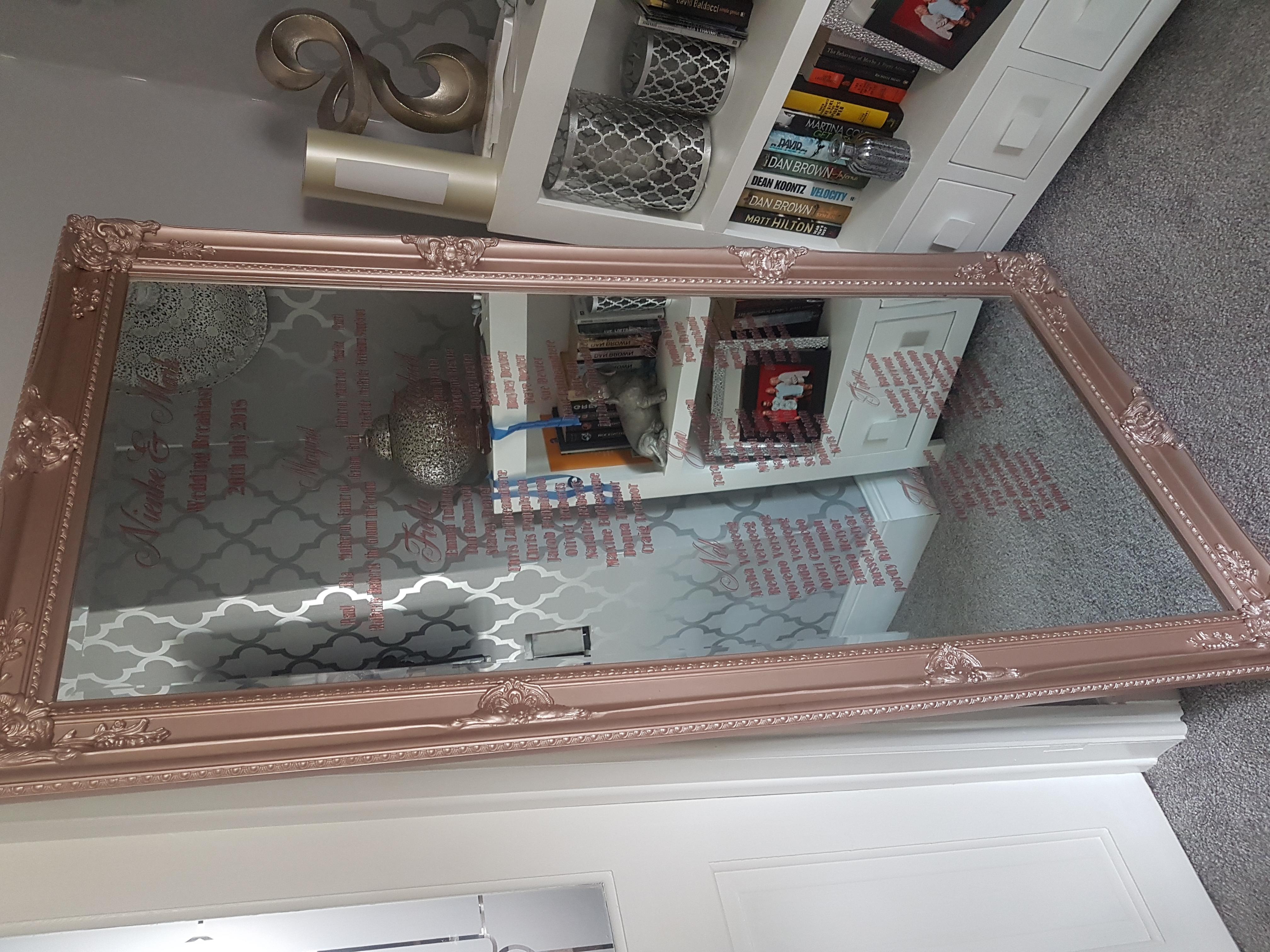 Vinyl table plan on floor mirror
