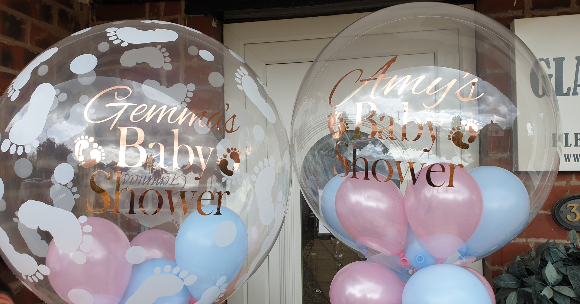 Footprint bubble with pink & blue balloons for baby shower