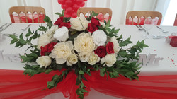 Artificial white, ivory and red top table decoration
