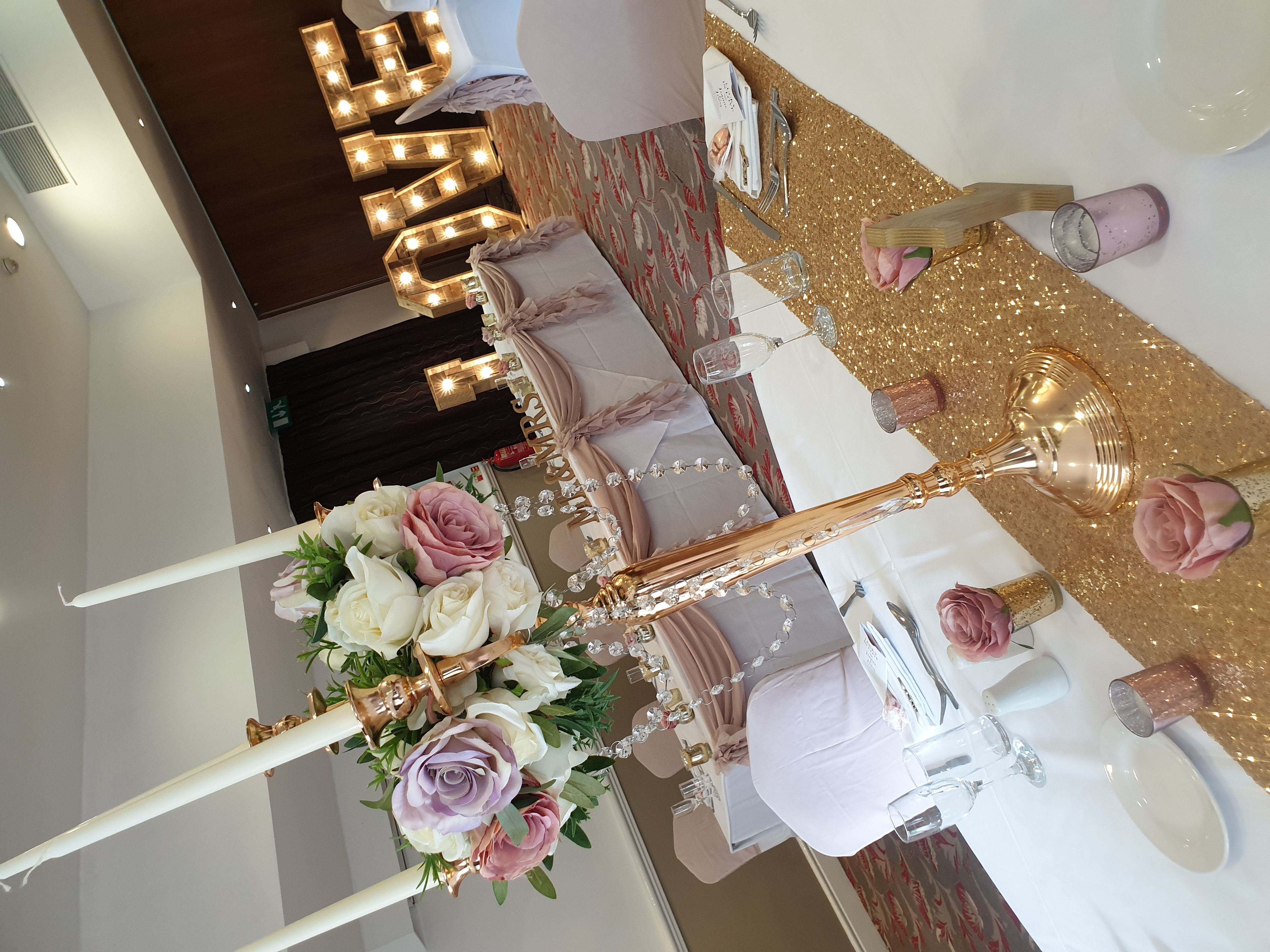 Gold Candelabra with artificial flowers