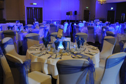 White Chair Covers With Side Tied Royal Blue Sash