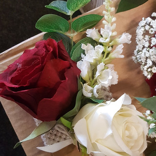 Artfifical red & ivory corsage