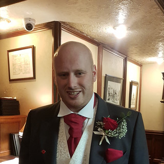 Fresh red rose buttonhole with gyp