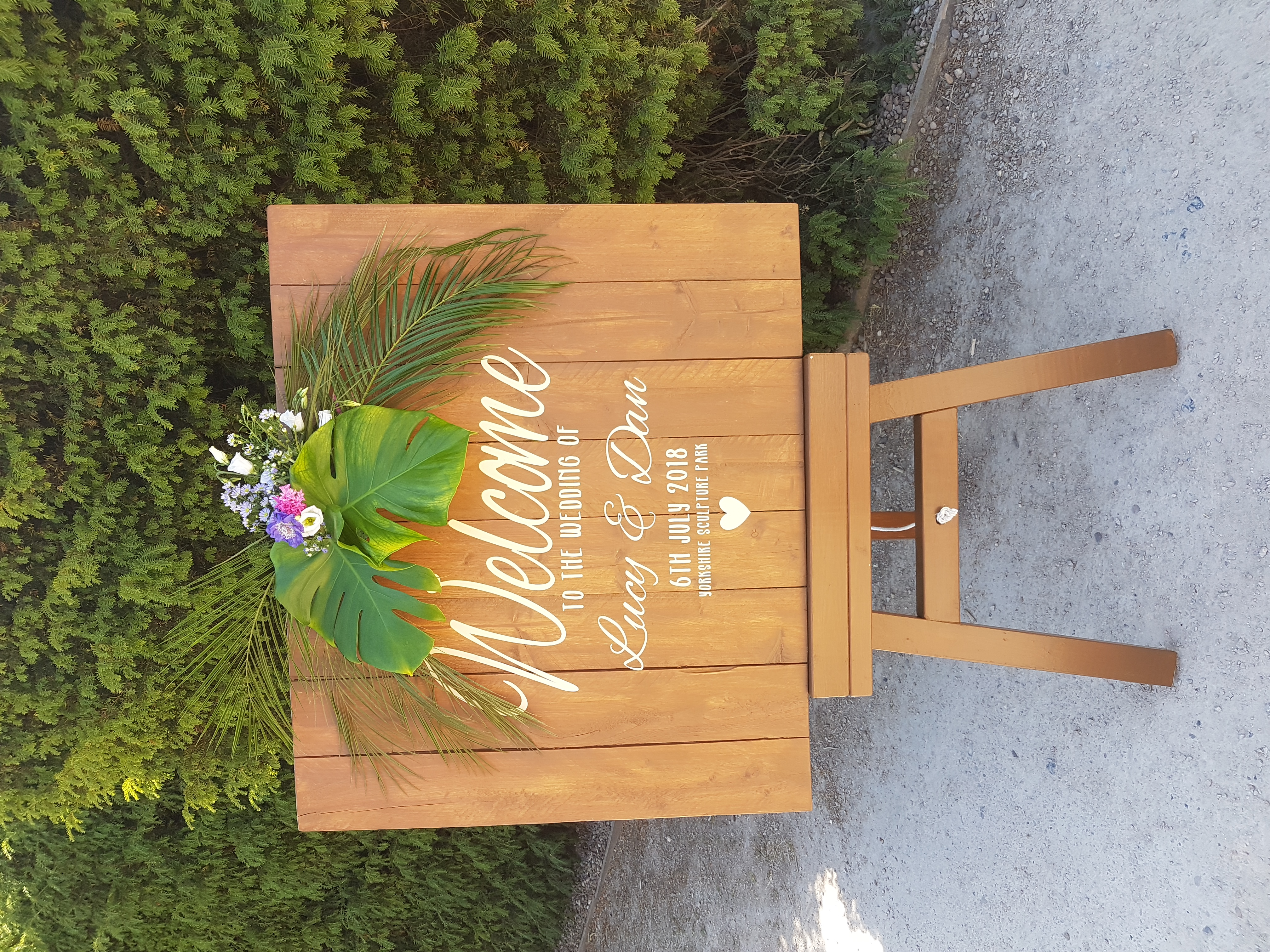 Vinyl welcome sign on rustic easel