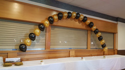 Gold and black buffet Arch