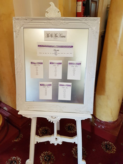 Table plan on ornate mirror & easel