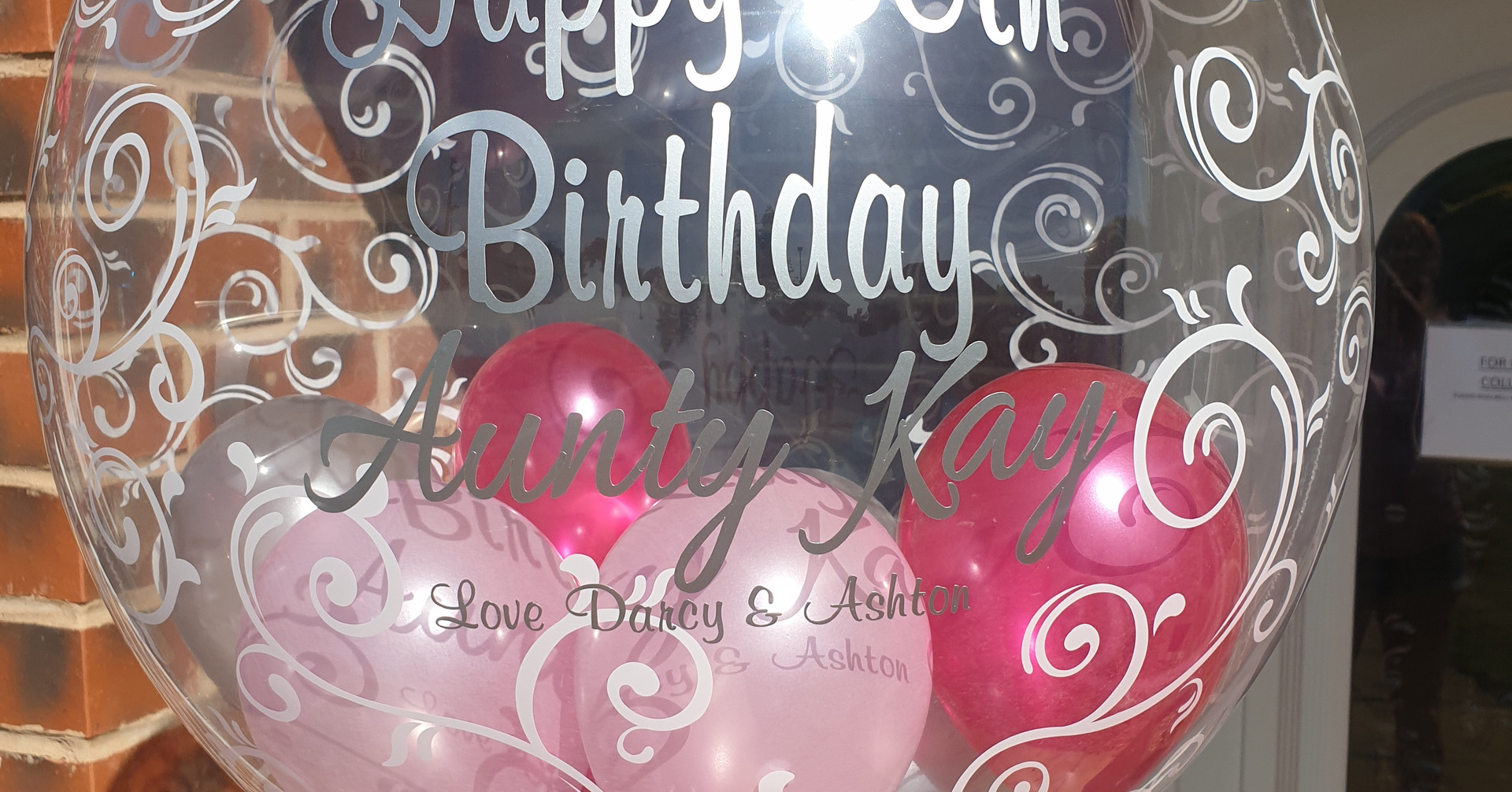 Script bubble with light, hot pink & silver birthday bubble balloon