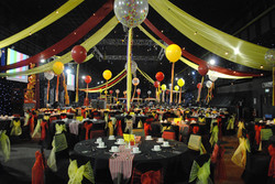 Black Chair Covers With Red & Yellow Sash