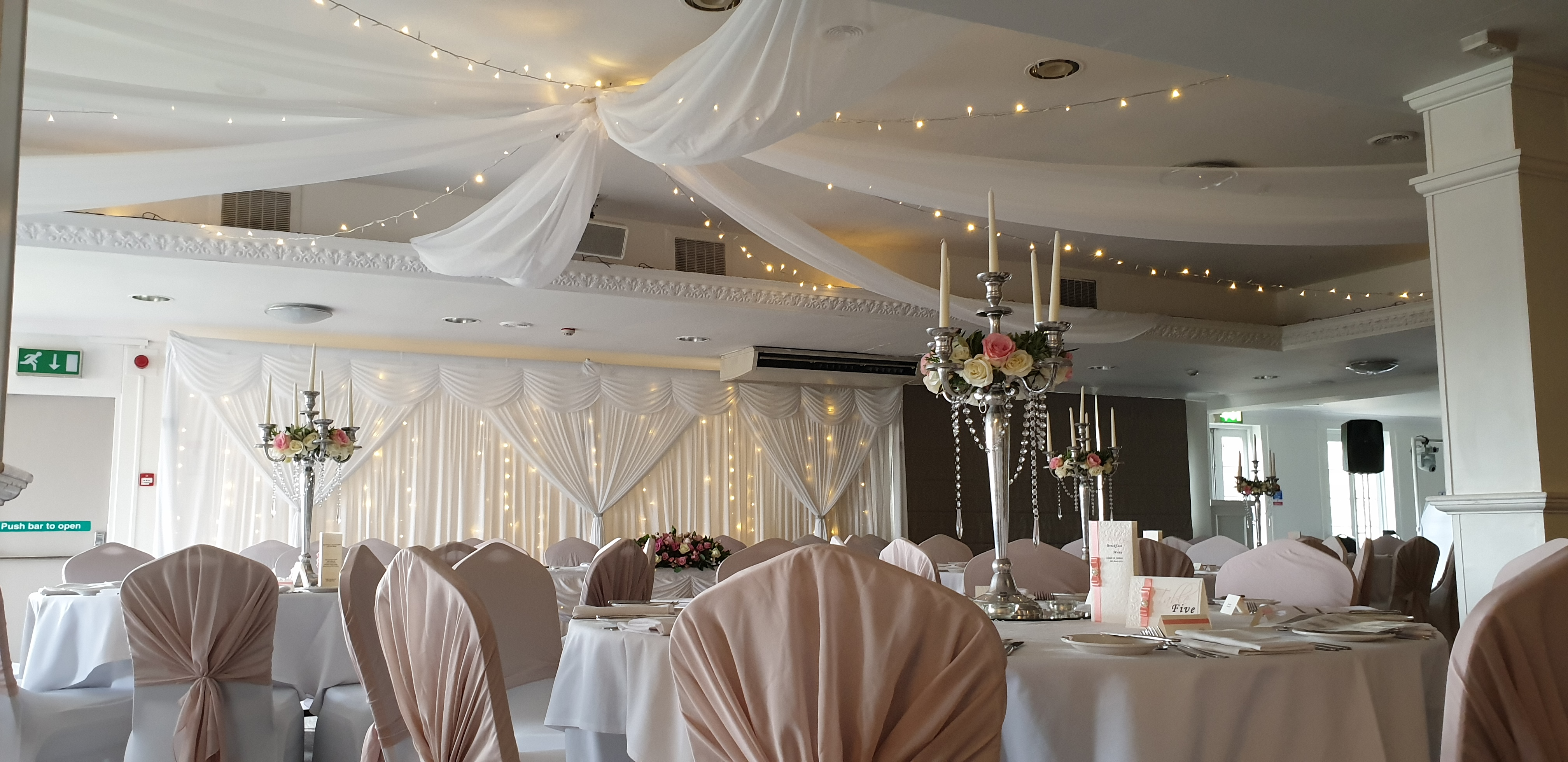 White Ceiling Swags with Warm White Lights