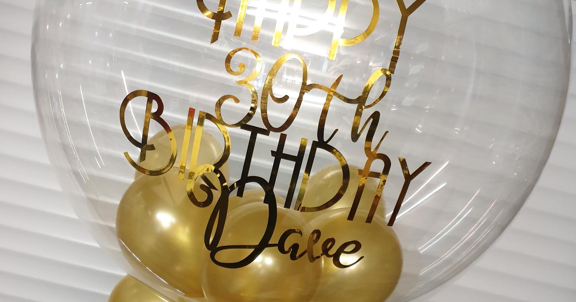 Gold bubble birthday balloon