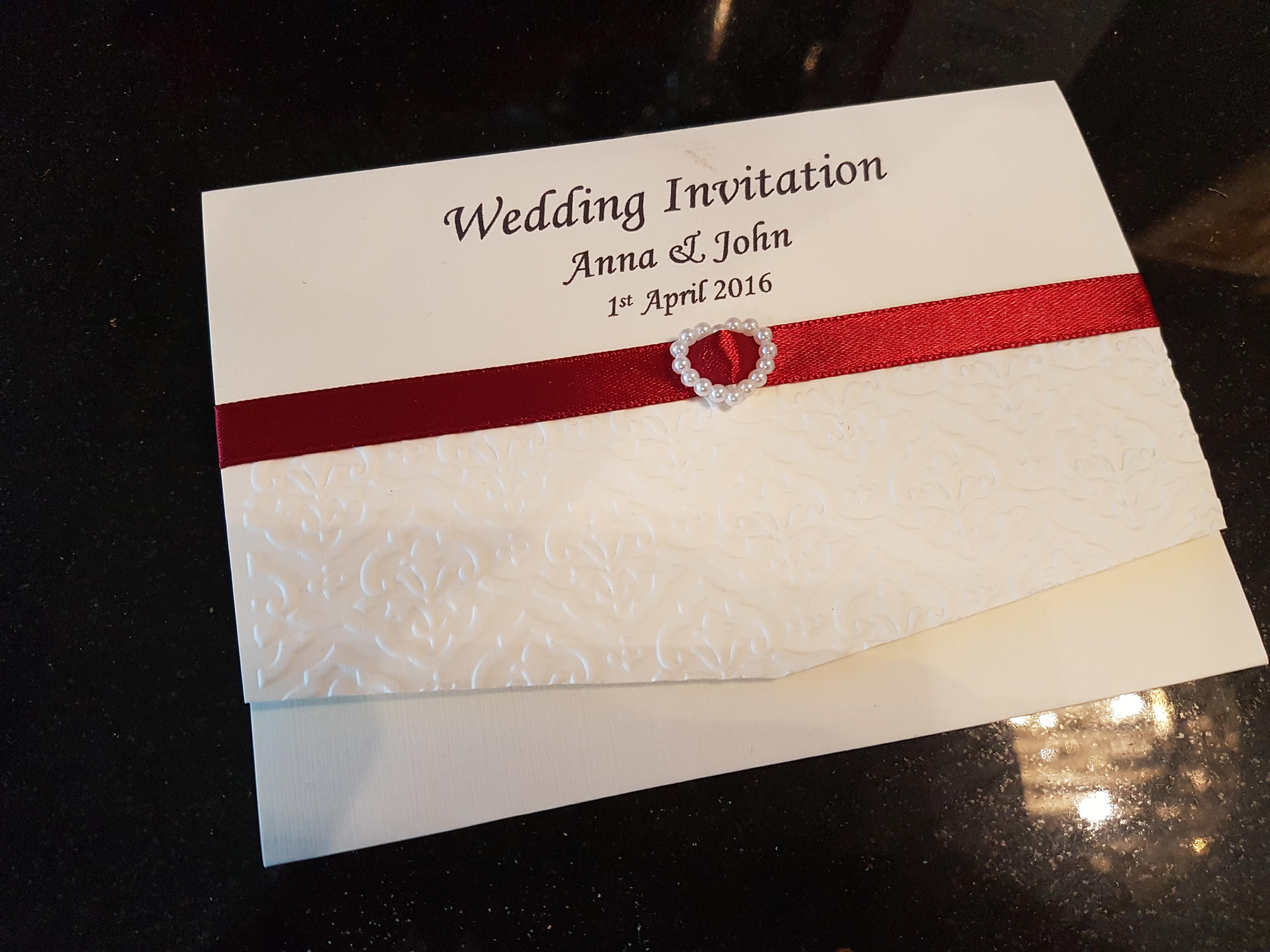 Pocket fold invitation embossed