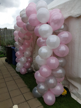 Silver pink and white spiral arch