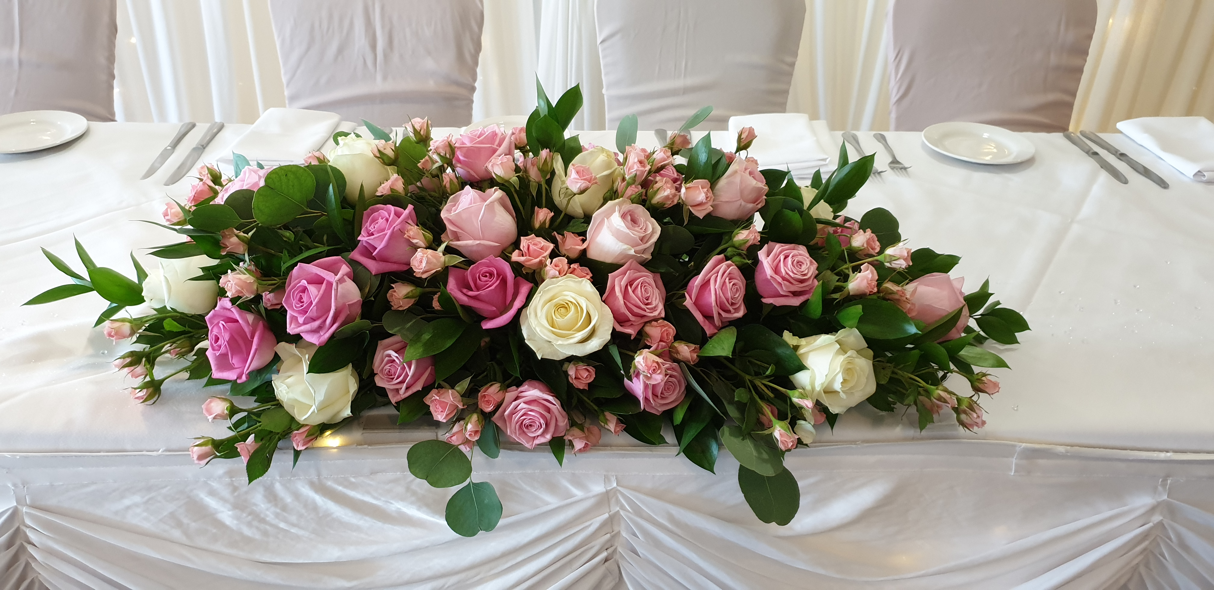 Fresh pink & Ivory rose top table decoration