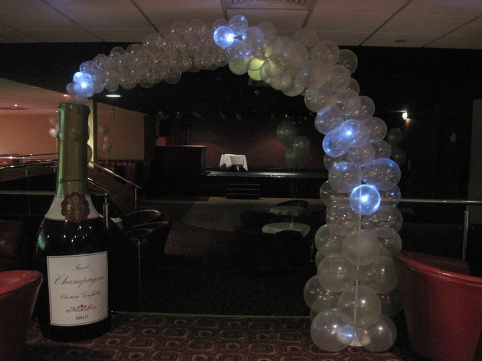 Twinkling champagne bottle arch