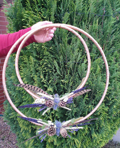Dried wheatgrass, pinecone, feathers and fresh thistle hoops