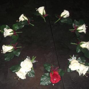 Artificial rose buttonholes