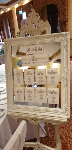 Dior Bow Table Plan on Ornate Ivory Mirror & Easel