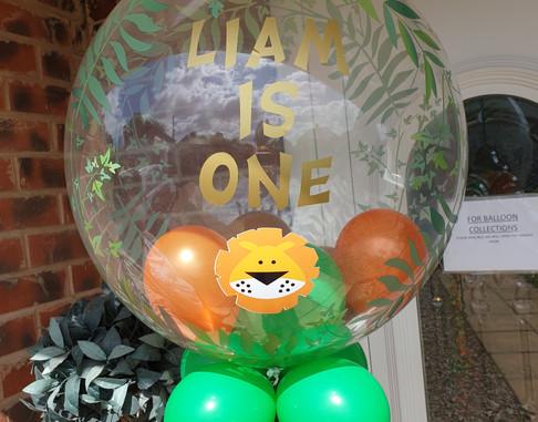 Leaf print jungle theme bubble with lion