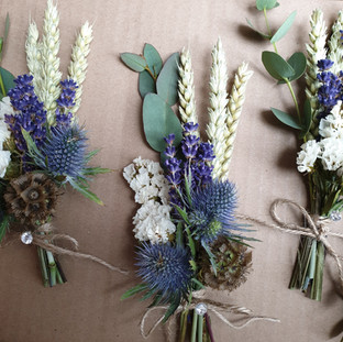 Dried wheatgrass, peacockfeather and fresh thistle buttonhole