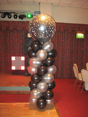 Silver and Black columns with 3ft Star Print Big Round Balloon Topper