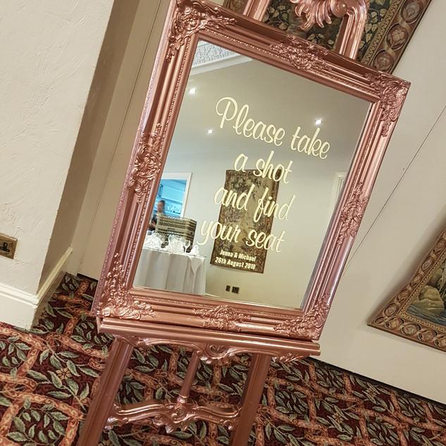 Rose gold framed mirror table plan/sign