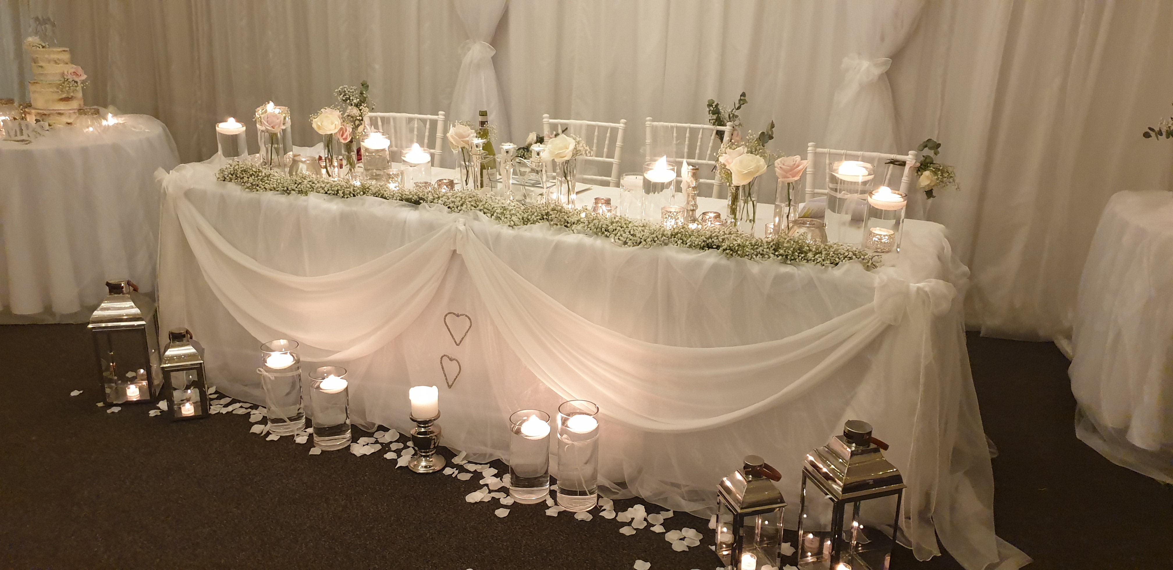 Fresh gyp garlands, fresh flower vases and lots of candles