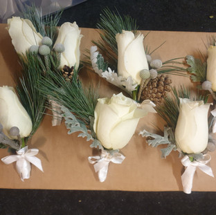 Fresh ivory rose, brunia & pinecone buttonhole