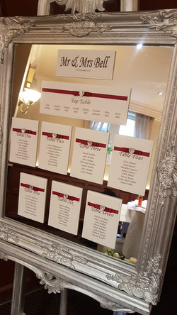 Dior Bow Red Table Plan on Silver Ornate Mirror & Easel