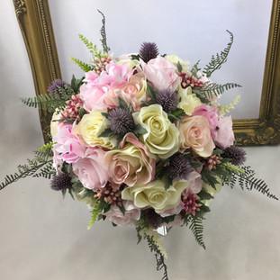Artificial rose & thistle bridal bouquet