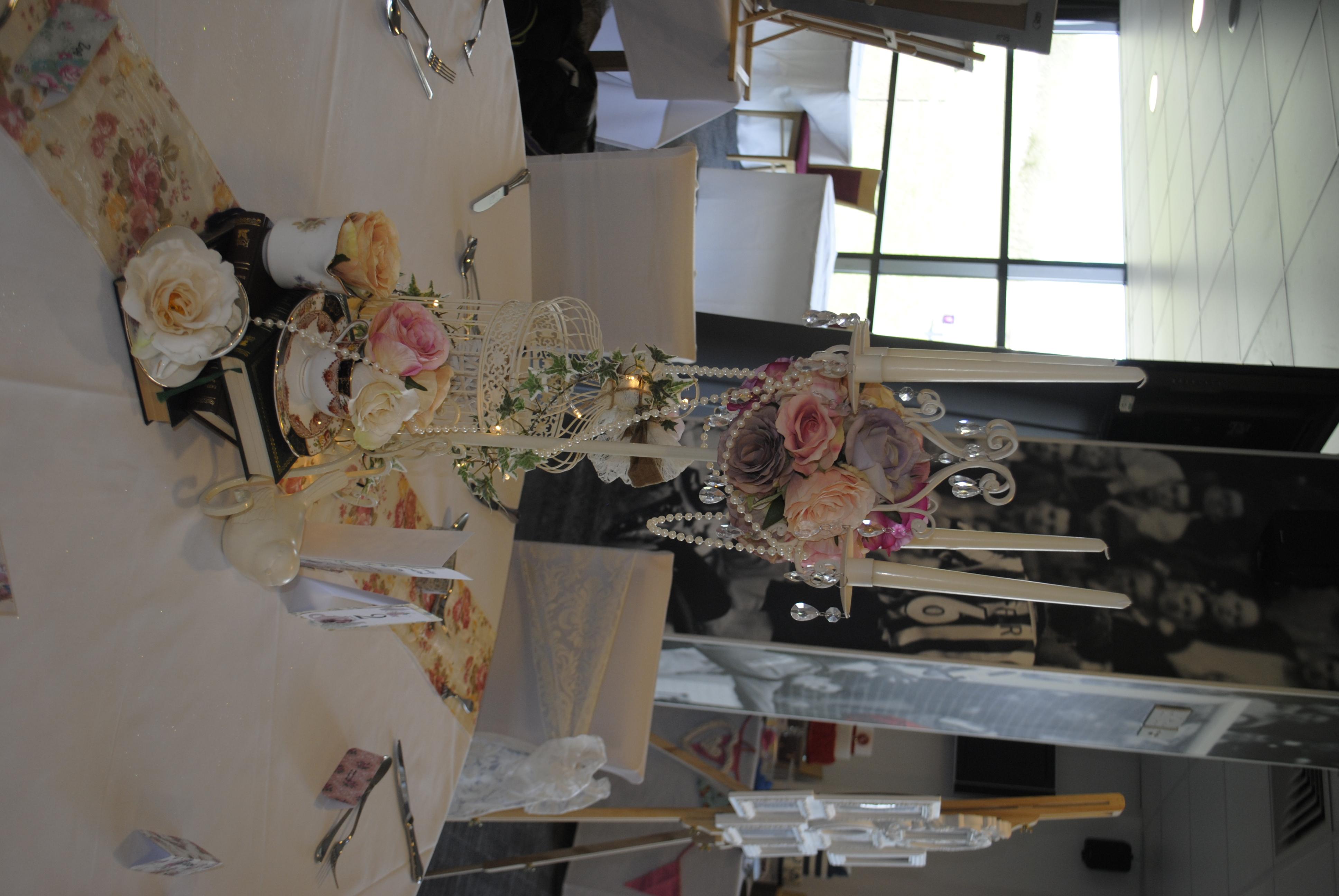 Cream Candelabra, birdcage and teacups