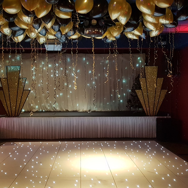 gold & black ceiling balloons