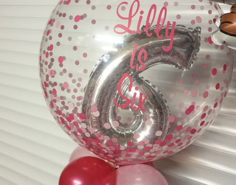 Pink confetti bubble with foil number 6