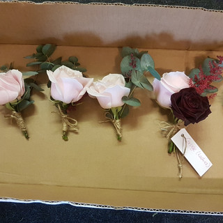 fresh pale pink & dark red roses buttonholes with eucalyptus