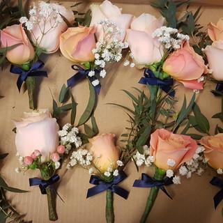 Peach roses, hypericum & gyp buttonholes