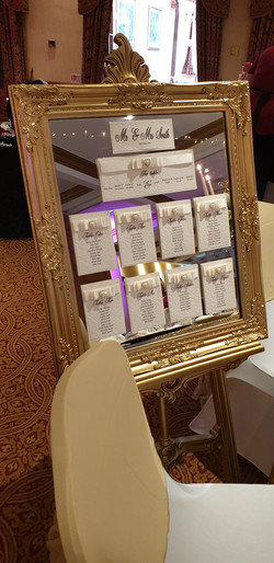 Dior Bow Table Plan on Ornate Gold Mirror & Easel