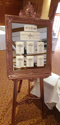 Dior Bow Table Plan on Ornate Rose Gold Mirror & Easel