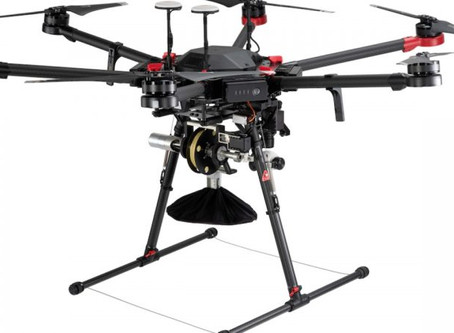 Drone noise an irritant? Delivery system drops packages from 150 ft by tether