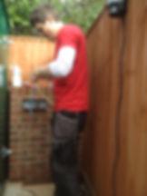Picture of Joel Groverworking in a garden.........