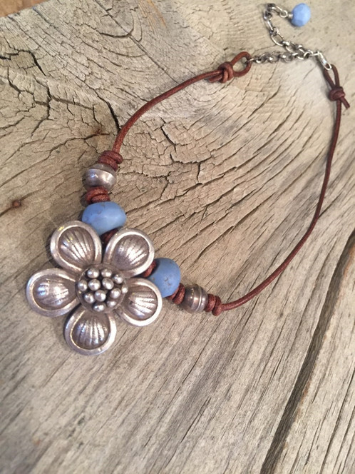 Antique eye skunk trade beads and bali sterling silver flower antique eye skunk trade beads and bali sterling silver flower pendant necklace aloadofball Choice Image