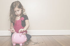 little%20girl%20putting%20money%20in%20h