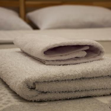 2 free towels in Skies #2,3,4 & 7; 1 free towel in #1,5 & 6.