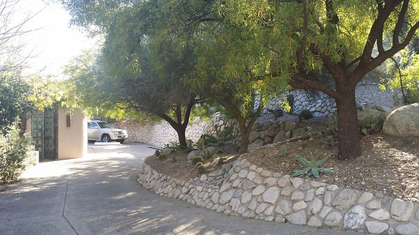 Mortar set retaining wall in river rock