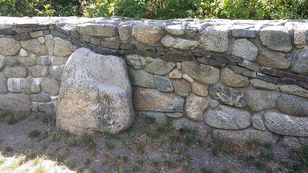 Mortar set river rock wall