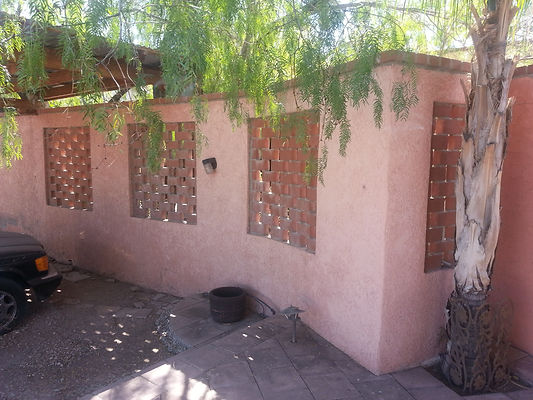 Landscape privacy wall with brick windows